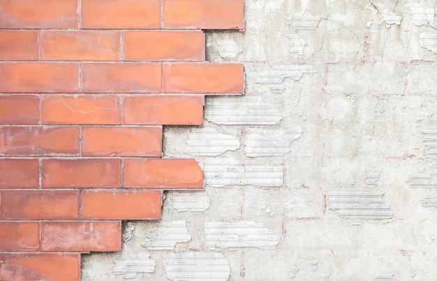 Mur de briques de pierre rouge closeup vieux et endommagé fond de texture
