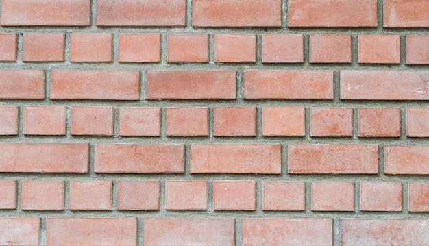 Mur de briques de pierre rouge gros plan