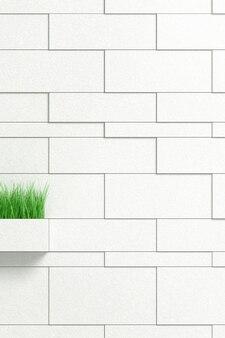 Mur de briques avec un pot en forme de rectangle et de végétation verte