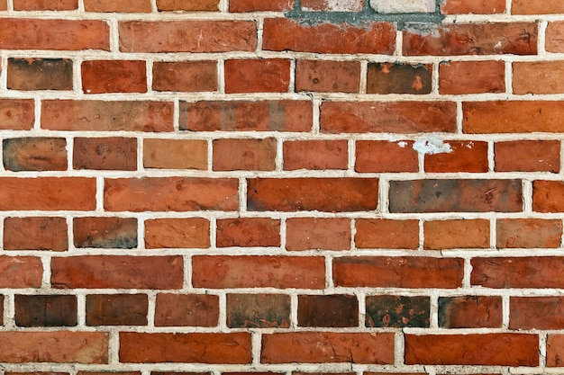 Mur de briques rouges, blocs dans un arrière-plan de ligne