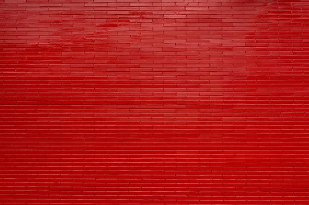 Mur de briques rouges et fini coulis