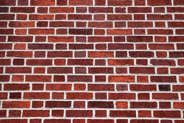 Mur de briques rouges à motifs de fond