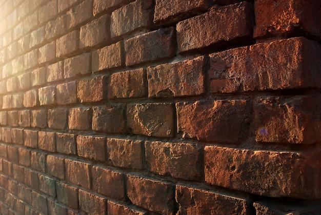 Mur de briques rouges en perspective, fond, texture