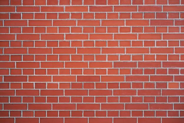 Mur de briques rouges pour le fond ou la texture. vieux fond de texture de mur de brique rouge