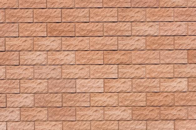 Un mur de briques rouges. surface texturée. photo de haute qualité