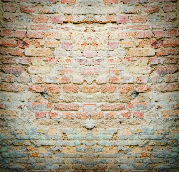 Mur de briques rouges texture fond grunge avec des coins vignettés de l'intérieur