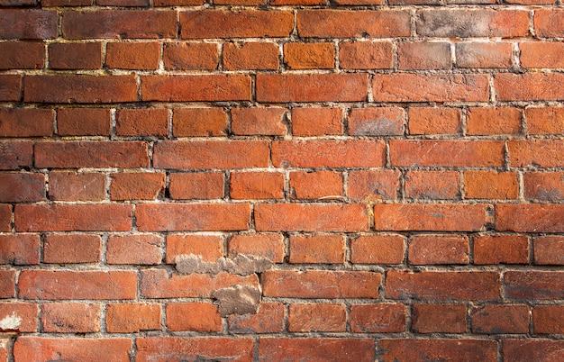 Mur de briques vintage vieux rouge.