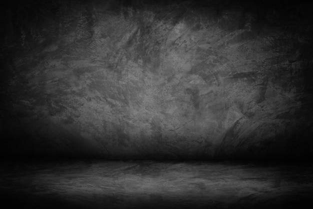 Mur de ciment abstrait noir et sombre et gris et fond dégradé de studio