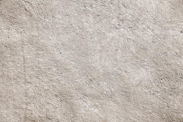 Mur de ciment ancien brut.