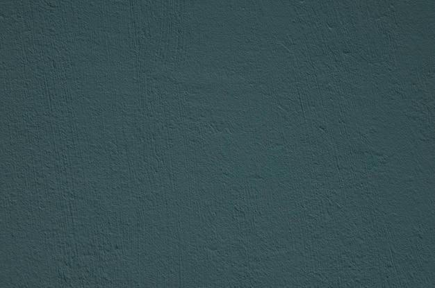 Mur de ciment bleu texturé rustique. toile de fond en béton.