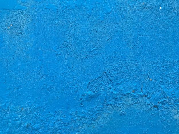 Mur de ciment le pastel bleu peint a des détails.