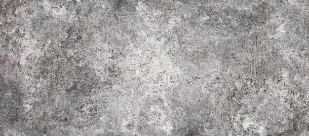 Mur de ciment à rayons grunge ou texture de surface en béton pour le fond.