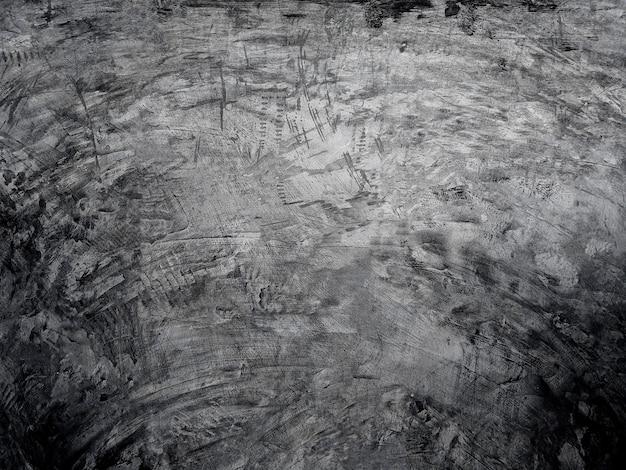 Mur de ciment un sol en ciment de fond noir