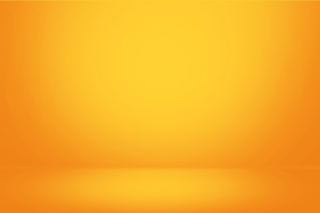 Mur dégradé jaune et fond de salle studio vide