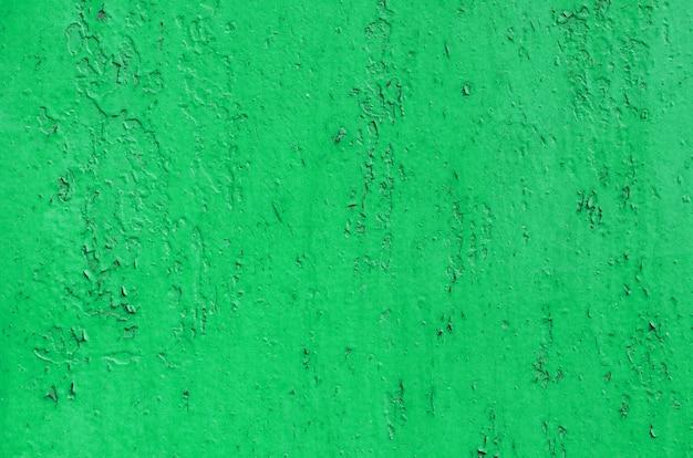 Mur de fer peint en vert vintage