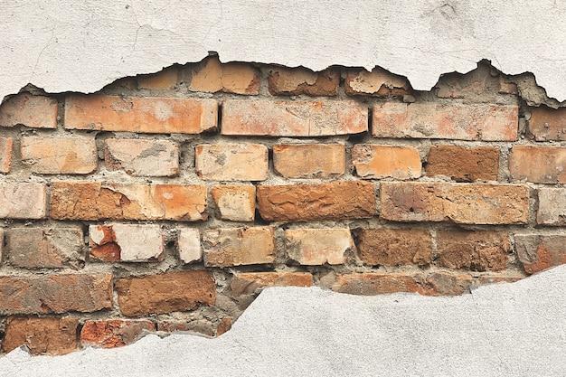 Mur avec fond de briques. texture de vieux mur.
