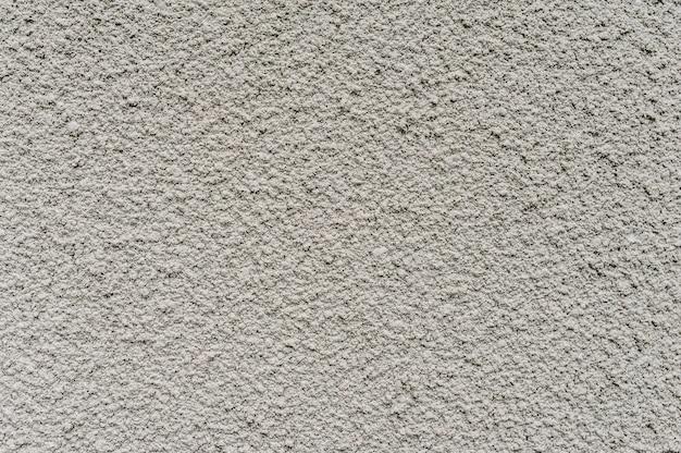 Mur de fond de texture blanc et gris. une structure rigide