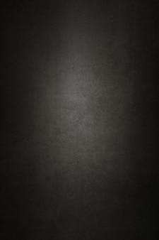 Mur de fond de vieux plâtre texturé noir.