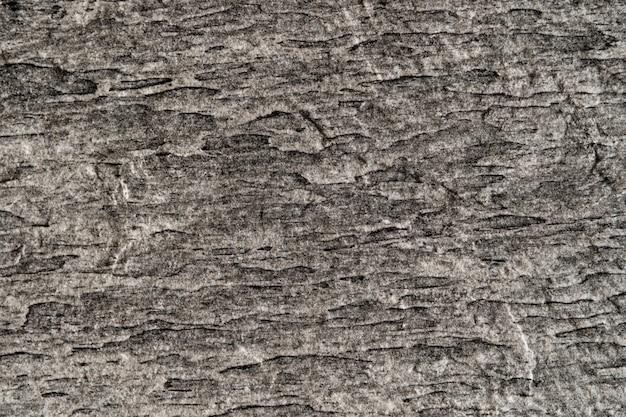 Mur de granit gris texturé pour le fond
