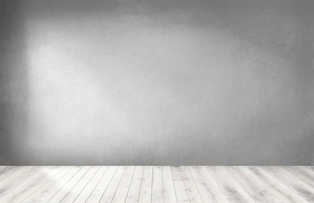 Mur gris dans une pièce vide avec un plancher en bois