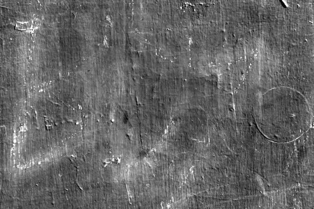 Mur gris avec des marques blanches