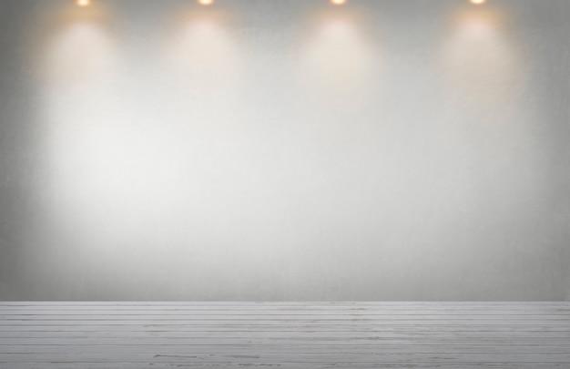 Mur gris avec une rangée de projecteurs dans une pièce vide