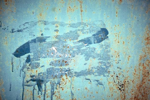 Mur en métal peint en bleu rouillé. fond de texture photo détaillée, espace de copie.