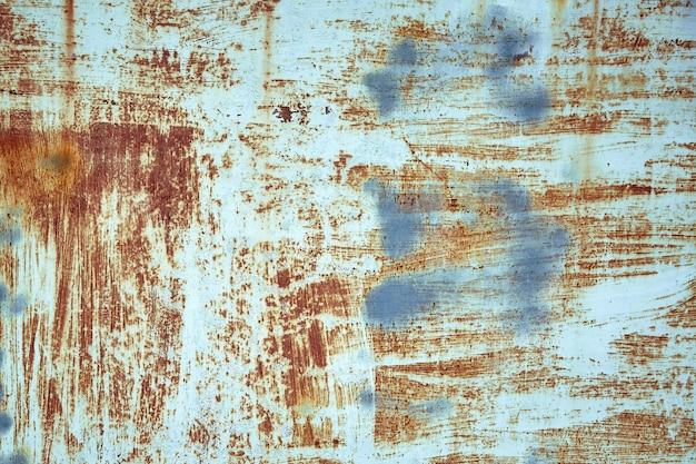 Mur en métal peint en bleu rouillé. texture photo détaillée