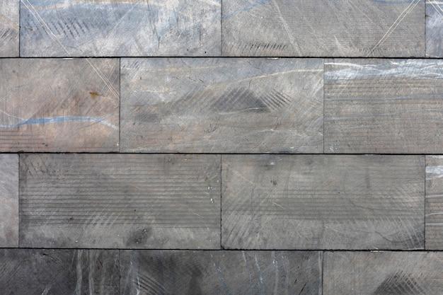 Mur moderne intérieur avec fond de plaquettes gris
