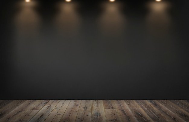 Mur noir avec une rangée de projecteurs dans une pièce vide