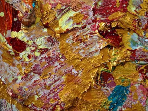 Mur d'or fond coloré et texturé.