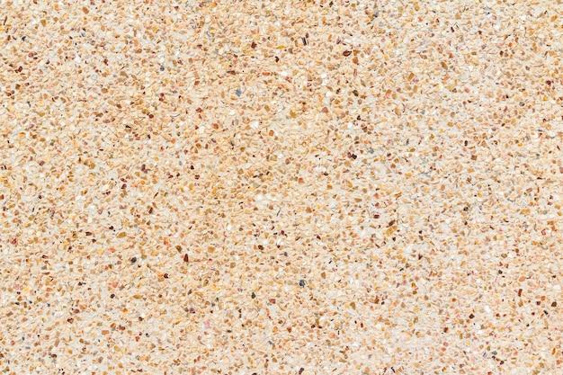 Mur de petites pierres ou fond de texture de mur de galets et de sable