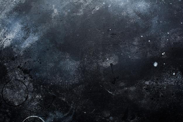 Mur de pierre ou d'ardoise noir foncé. fond de texture grunge.