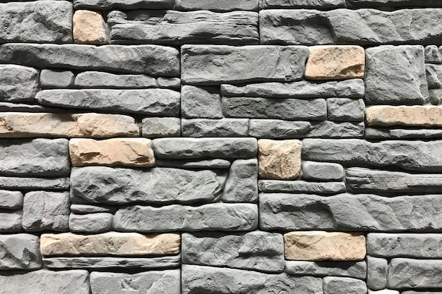 Mur de pierre de couleur grise. texture et fond de design d'intérieur