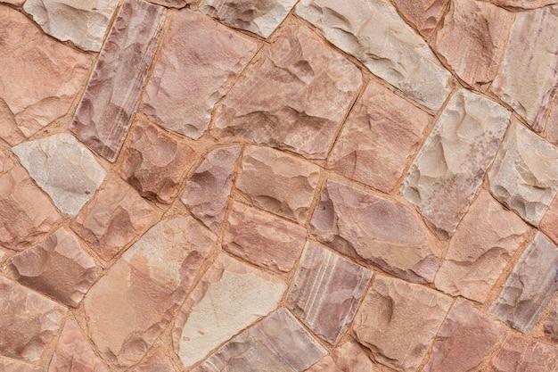Mur de pierre décorative sur fond de tons roses