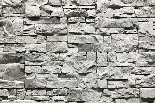 Mur de pierre avec un fond gris