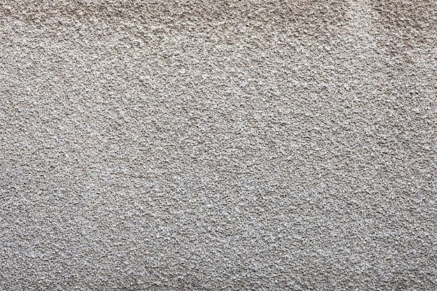 Mur de pierre grise avec une texture rugueuse. photo de haute qualité