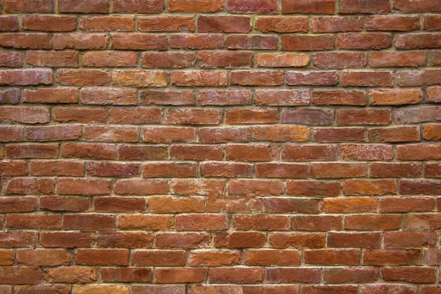 Mur de pierre de maçonnerie de fond de blocs rouges pour la conception