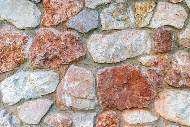 Mur de pierre de marbre violet et rose. closeup surface grunge texture de pierre, modèle ancien de pierre de roche.