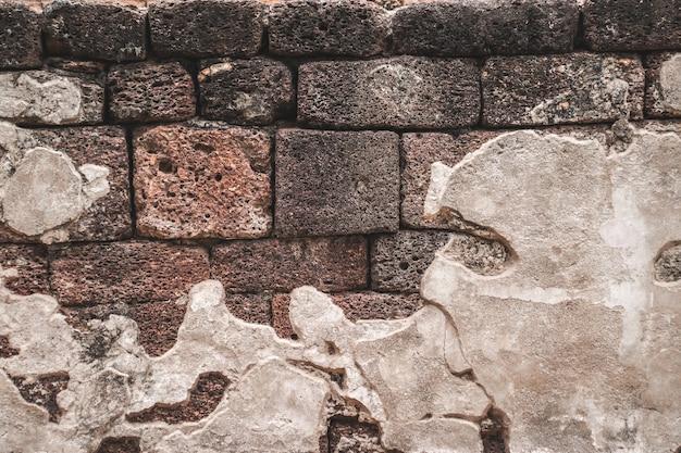 Mur de pierre naturelle colorée avec fond de texture de ciment.