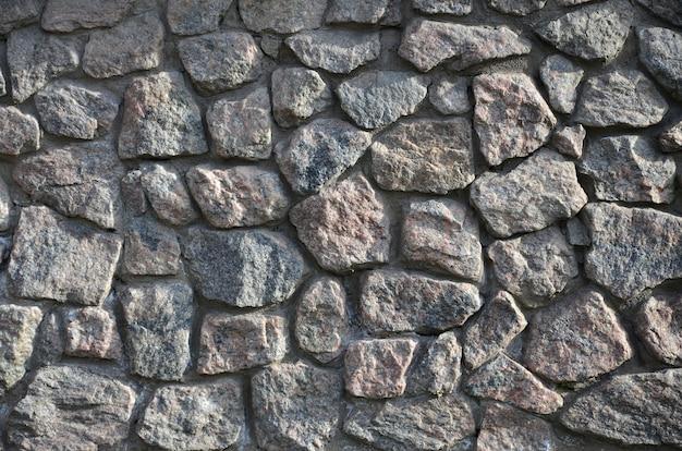 Mur de pierre patiné et rugueux