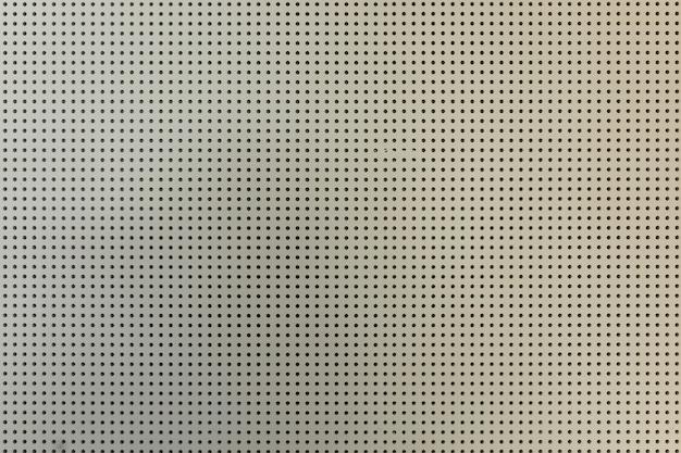 Mur en placoplâtre perforé clair blanc
