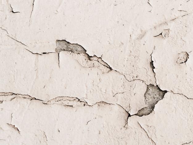 Mur de plâtre endommagé fond texturé