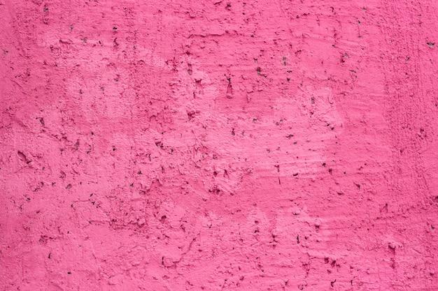 Mur recouvert de plâtre décoratif rose