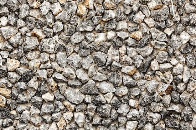 Mur rugueux construit en pierre.