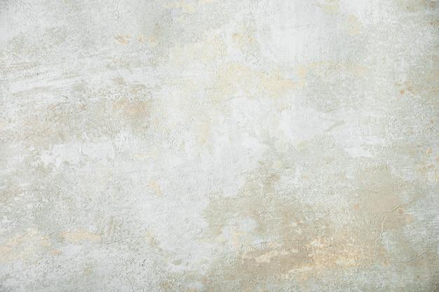 Mur de stuc texturé gris gros plan