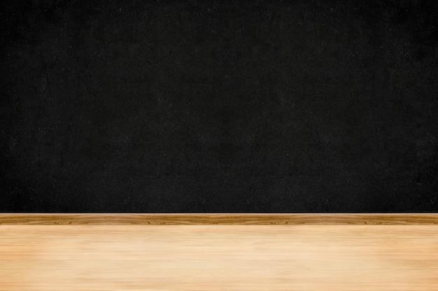 Mur de tableau noir en perspective et fond intérieur de plancher en bois