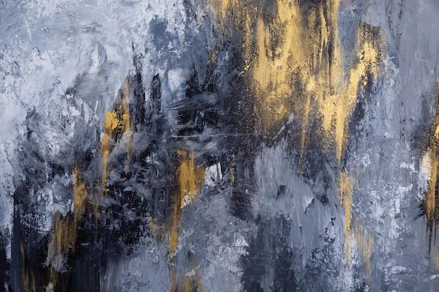 Mur texturé aux couleurs grises et dorées