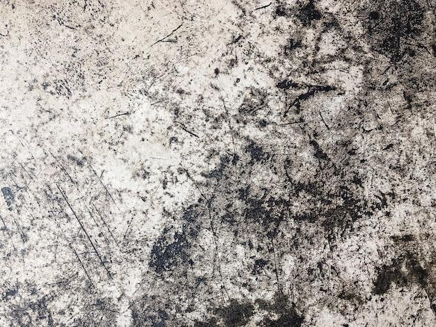 Mur texturé en béton gris grunge avec des rayures. copiez l'espace. contexte