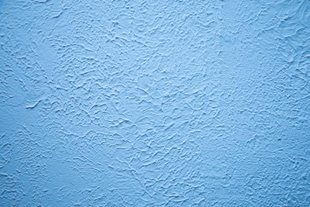 Mur texturé bleu. plâtrage décoratif